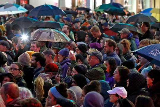 A crowd gathers at the intersection of Murray Ave. and Forbes Ave. in the Squirrel Hill section of Pittsburgh during a memorial vigil for the victims of the shooting at the Tree of Life Synagogue, Saturday, Oct. 27, 2018.