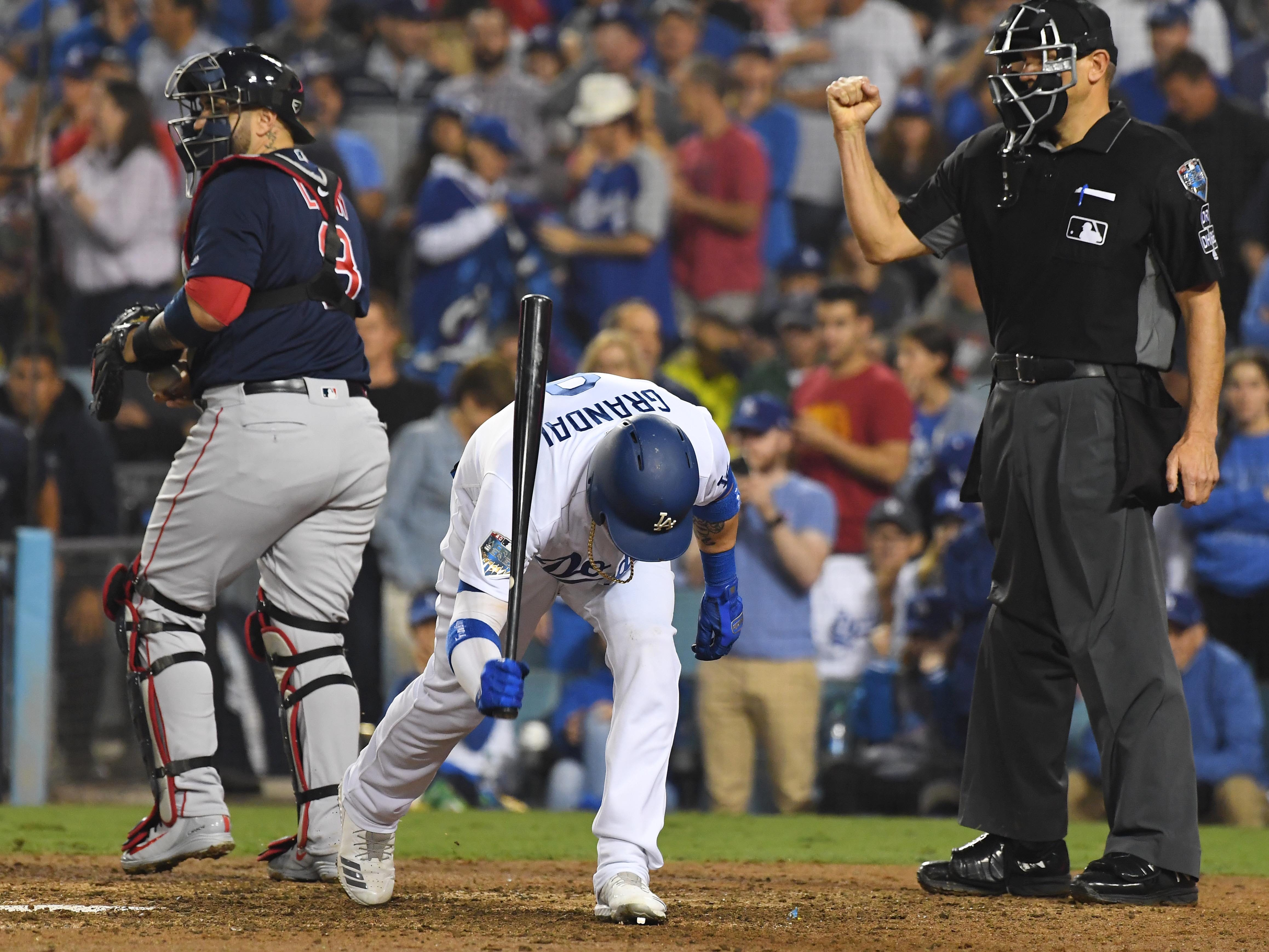 Game 4 at Dodger Stadium: Yasmani Grandal reacts after striking out in the eighth.