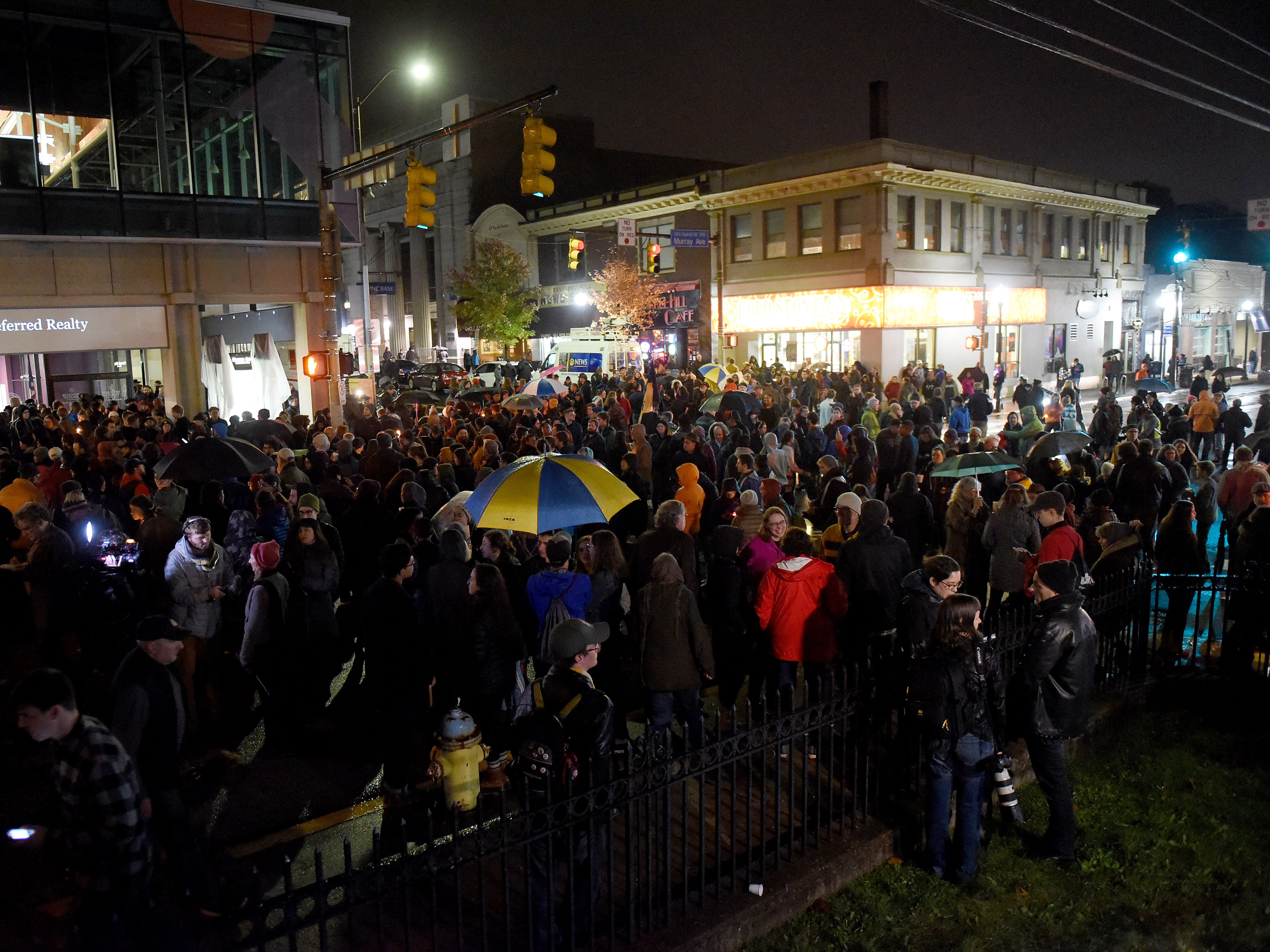 Mourners gather in the Squirrel Hill neighborhood of Pittsburgh for a vigil.