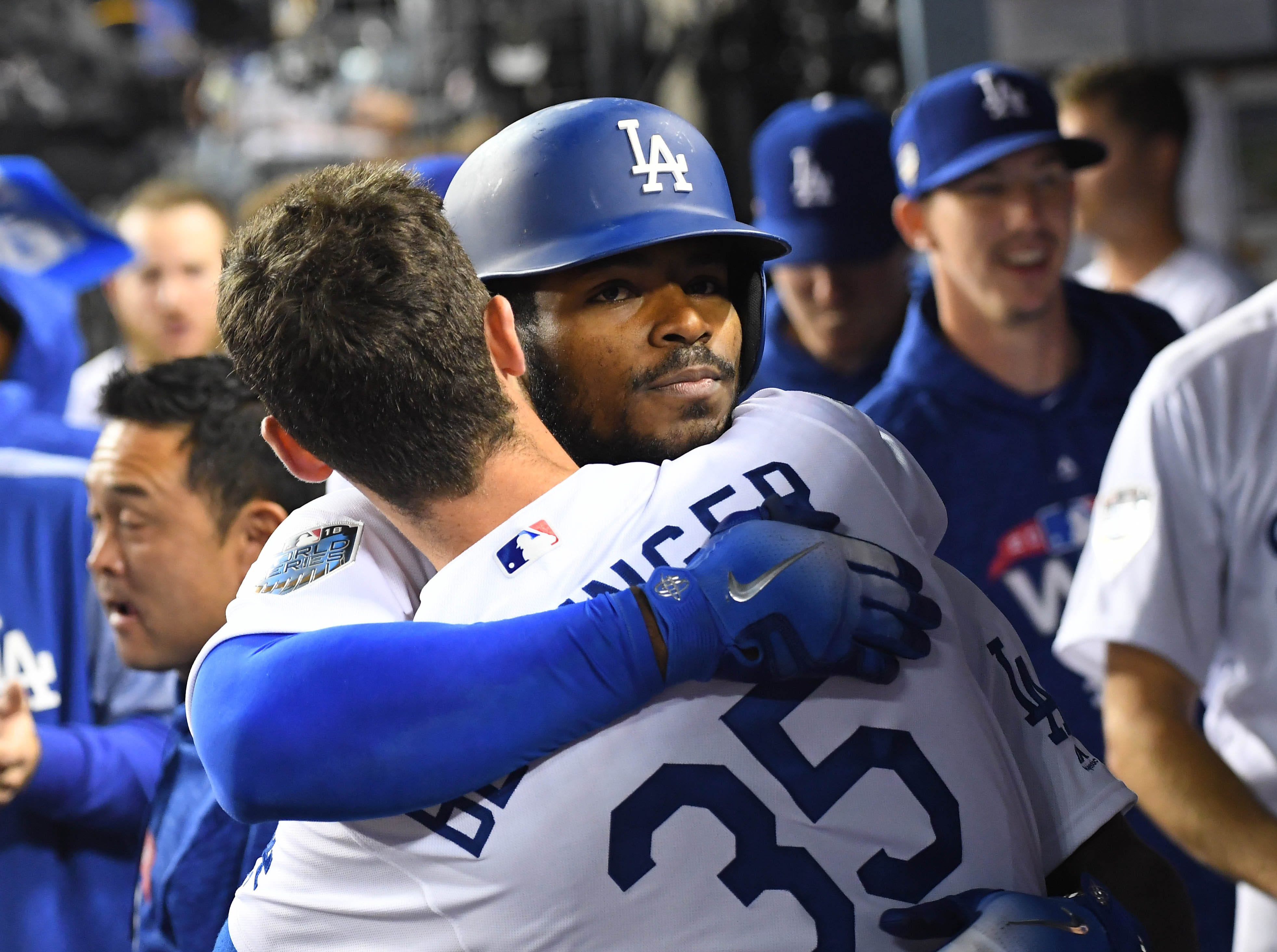 Game 4 at Dodger Stadium: Yasiel Puig celebrates his home run in the dugout with Cody Bellinger.