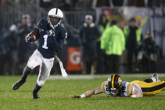 Penn State Nittany Lions wide receiver KJ Hamler (1) runs with the ball on a punt return during the fourth quarter against the Iowa Hawkeyes at Beaver Stadium.