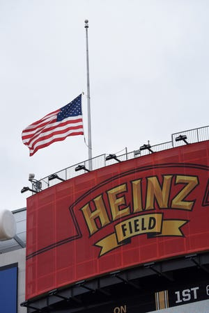 The flag flies half-staff at Heinz Field before the Pittsburgh-Cleveland game to recognize the 11 people shot and killed in Tree of life synagogue.
