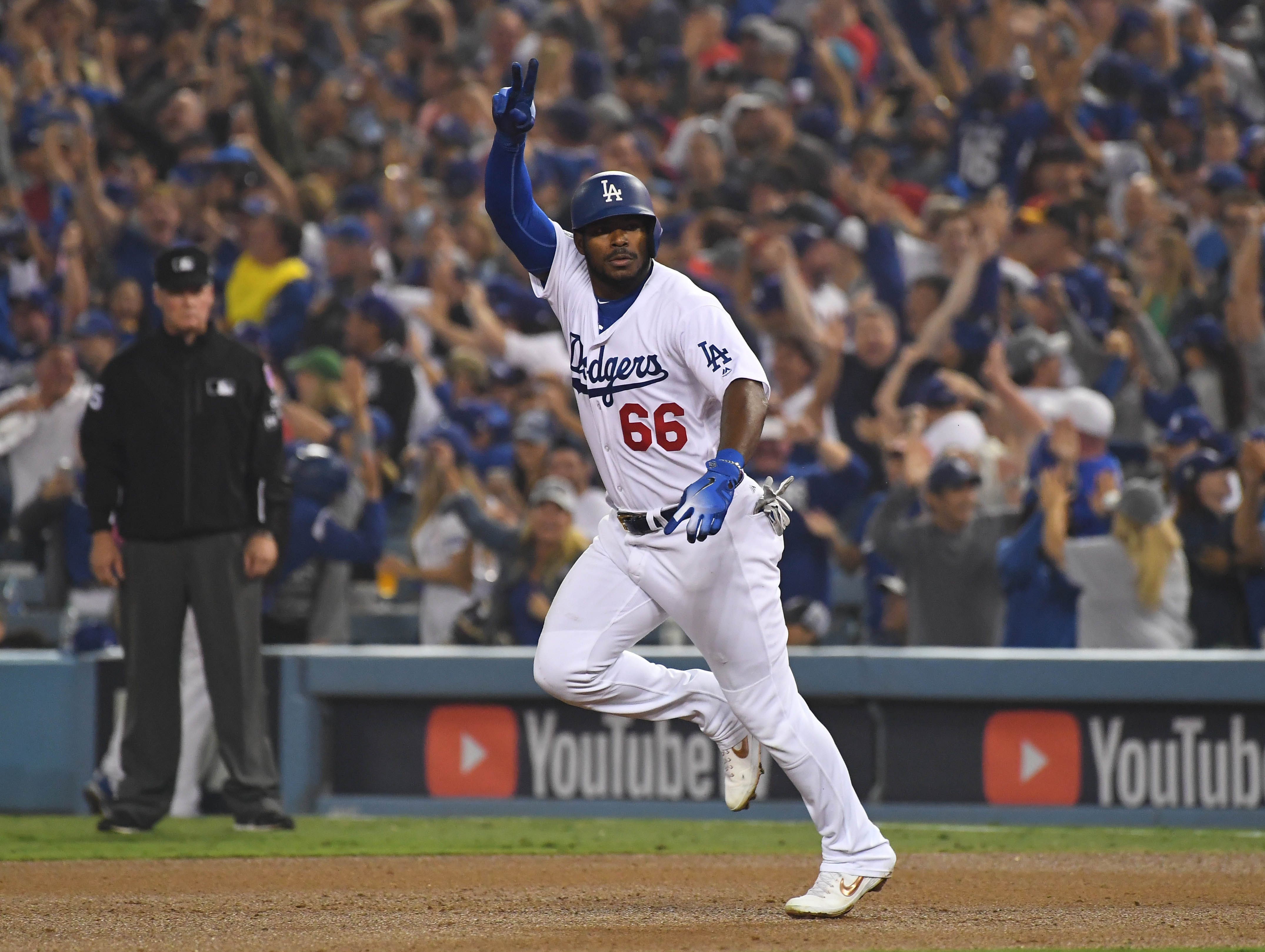 Game 4 at Dodger Stadium: Yasiel Puig rounds the bases after his three-run homer in the sixth.
