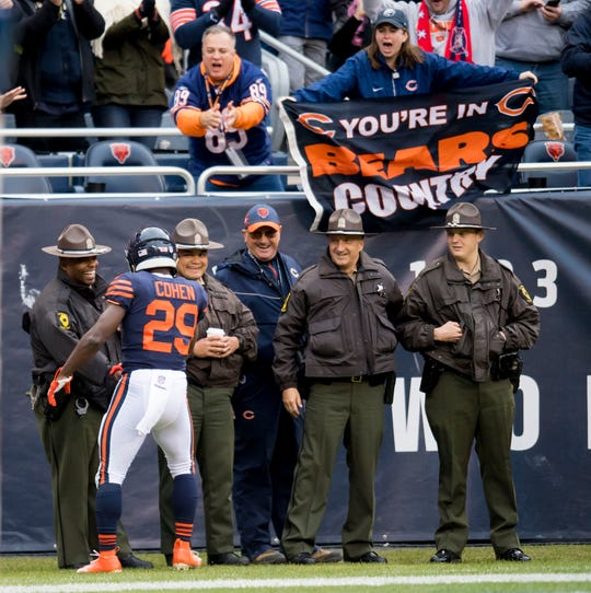Chicago Bears running back Tarik Cohen celebrates his touchdown Illinois State Police officers during the first half against the New York Jets at Soldier Field.