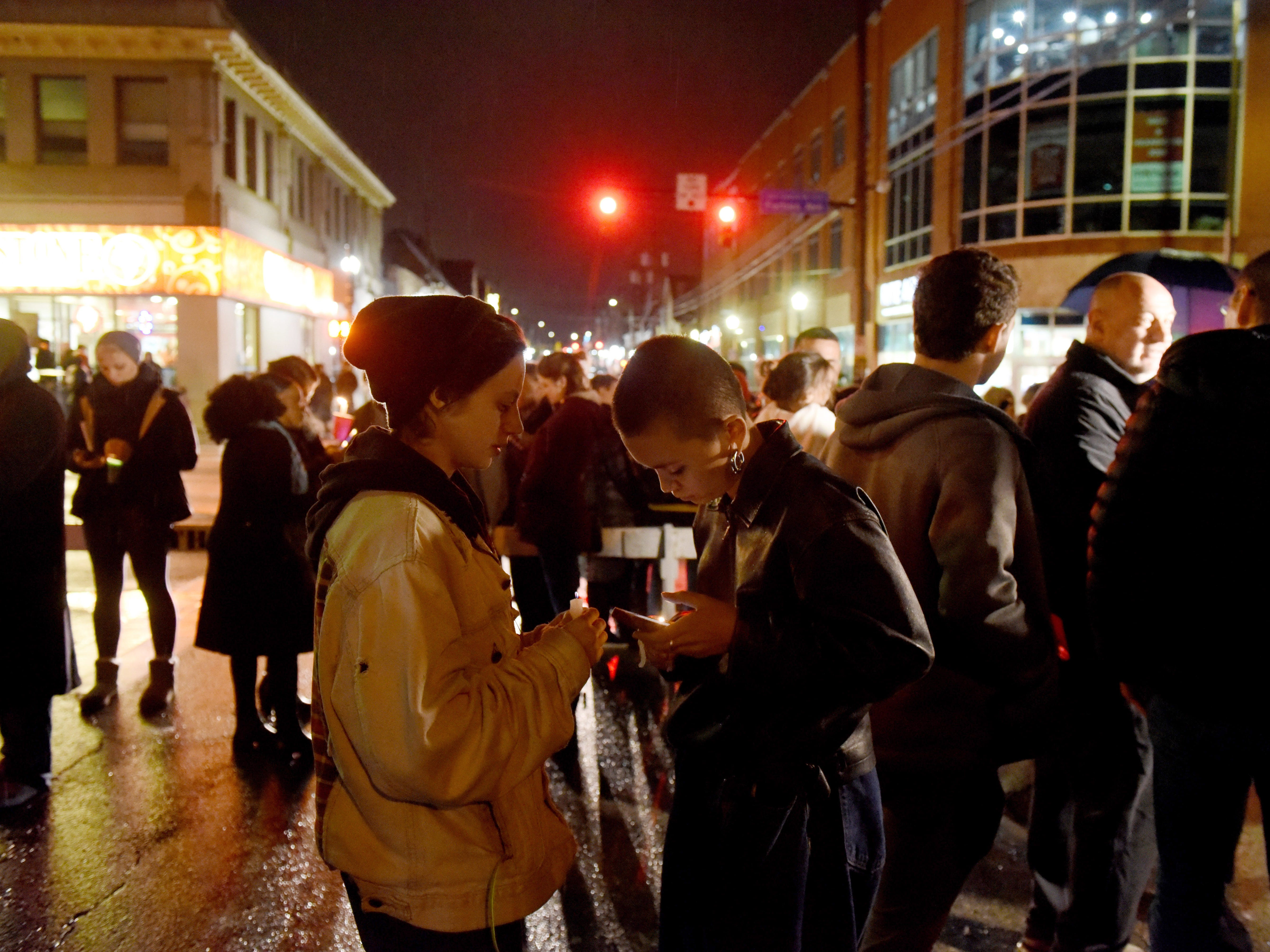 Mourners gather for a vigil in the Squirrel Hill neighborhood of Pittsburgh.