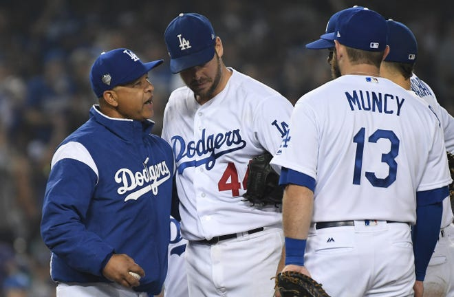 Dodgers manager Dave Roberts relieves Rich Hill in the seventh inning in Game 4. The Dodgers were up 4-0 at the time.