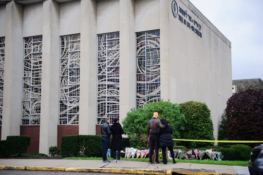 Mourners place flowers outside the Tree of Life synagogue, Oct. 28, 2018, Pittsburgh.