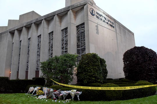 Flowers lay outside of the Tree of Life Congregation Synagogue in the Squirrel Hill neighborhood of Pittsburgh, Sunday, Oct. 28, 2018.