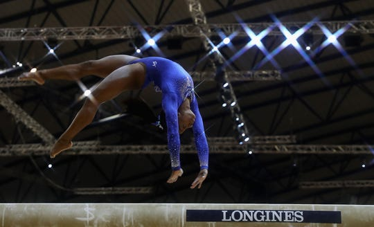 Simone Biles competes in the balance beam  qualification during the 2018 FIG Artistic Gymnastics Championships at Aspire Dome on Oct. 27, 2018 in Doha, Qatar.