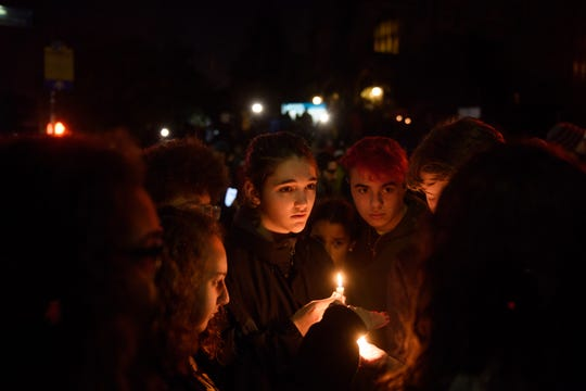 People gather for a interfaith candlelight vigil a few blocks away from the site of a mass shooting at the Tree of Life Congregation in Pittsburgh.