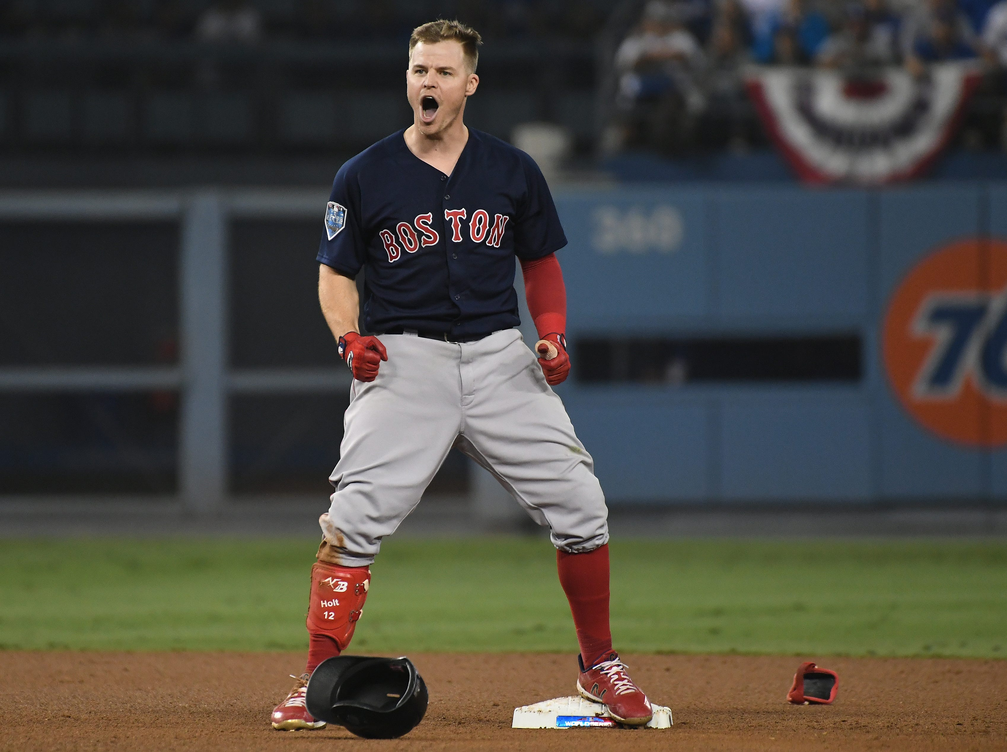 Game 4 at Dodger Stadium: Brock Holt reacts after hitting a double in the ninth.