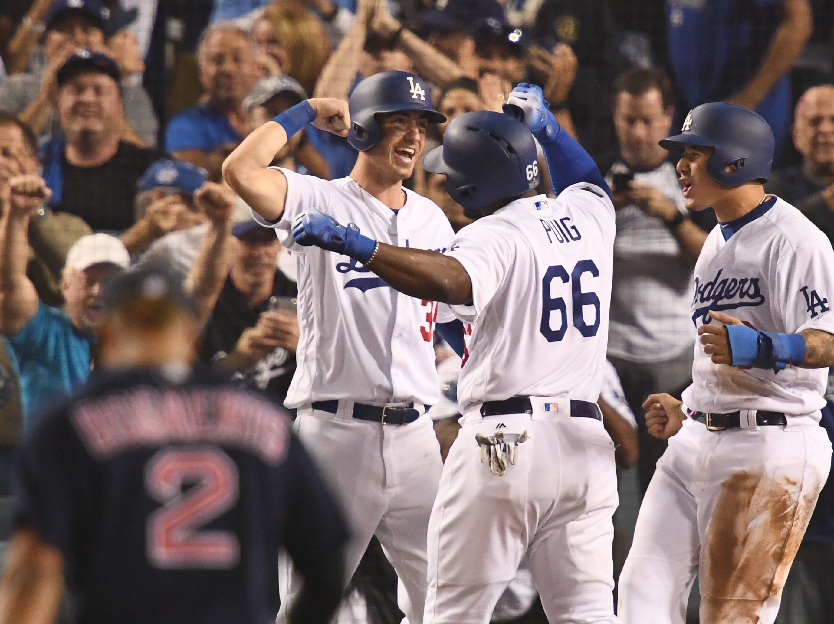 Game 4 at Dodger Stadium: Dodgers players celebrate Yasiel Puig's three-run homer in the sixth.