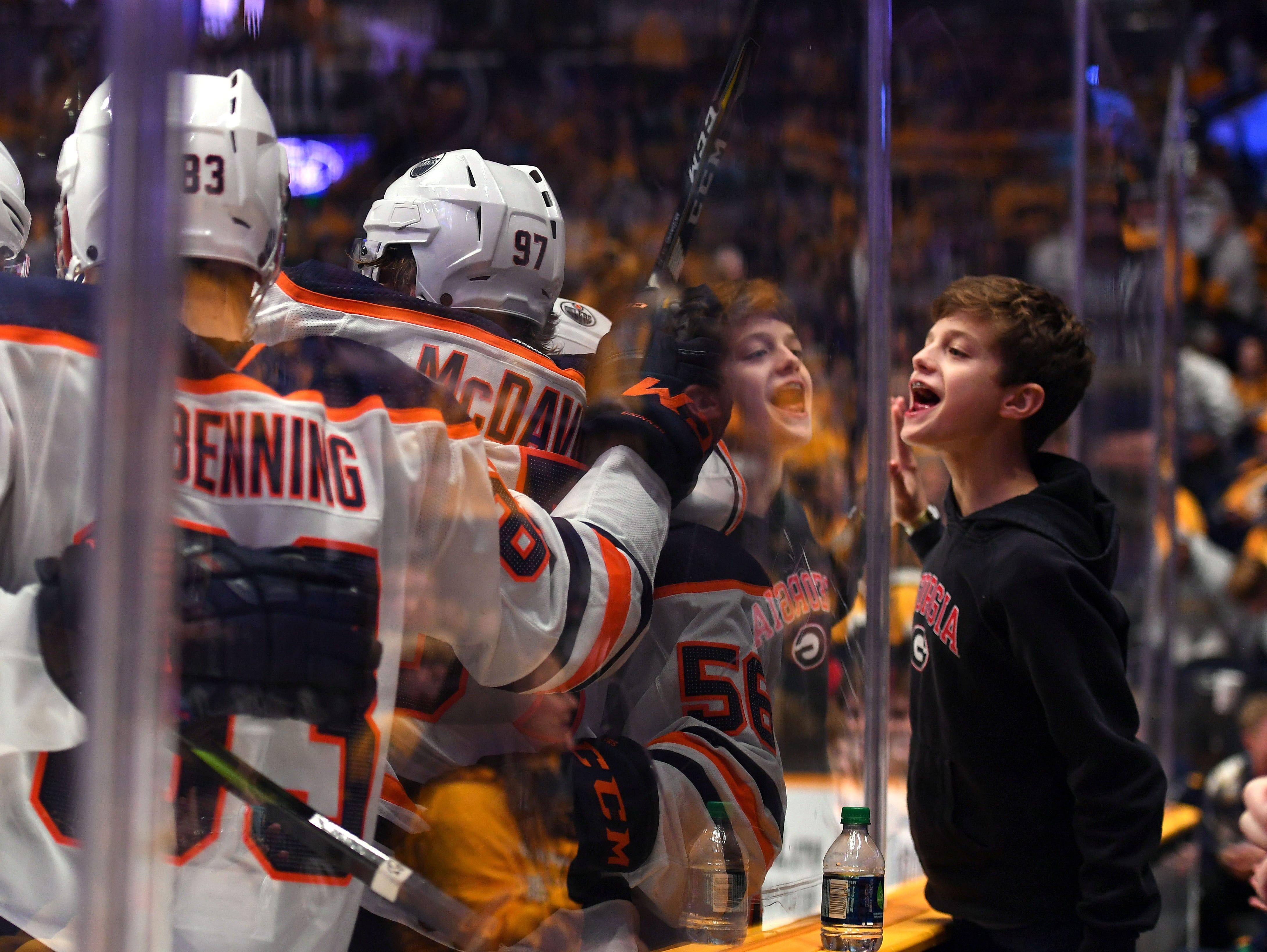 Oct. 27: Edmonton Oilers players celebrate after a goal by Connor McDavid (97) against the Nashville Predators at Bridgestone Arena.