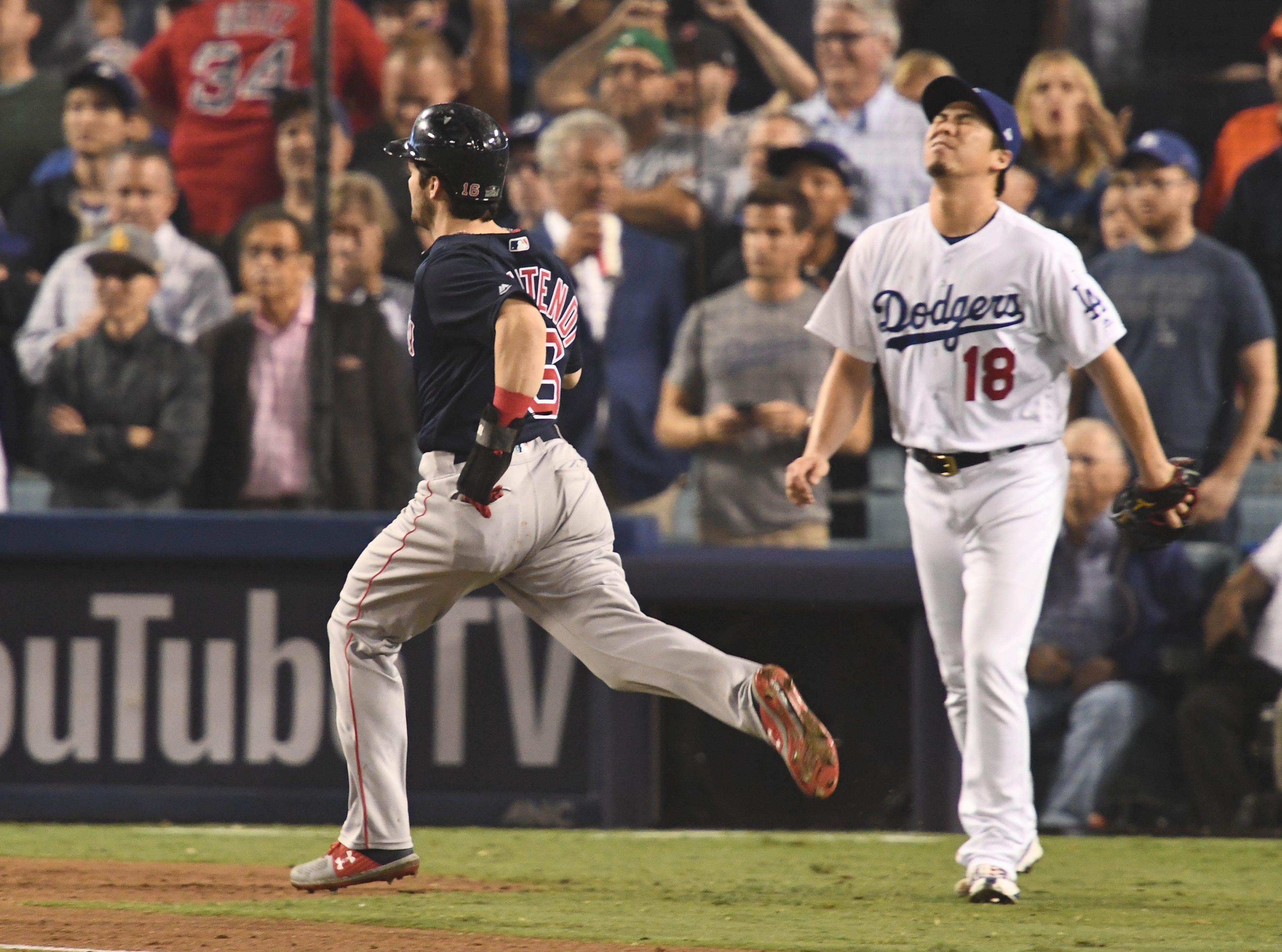 Game 4 at Dodger Stadium: Andrew Benintendi scores a run in the ninth inning as Kenta Maeda looks on.
