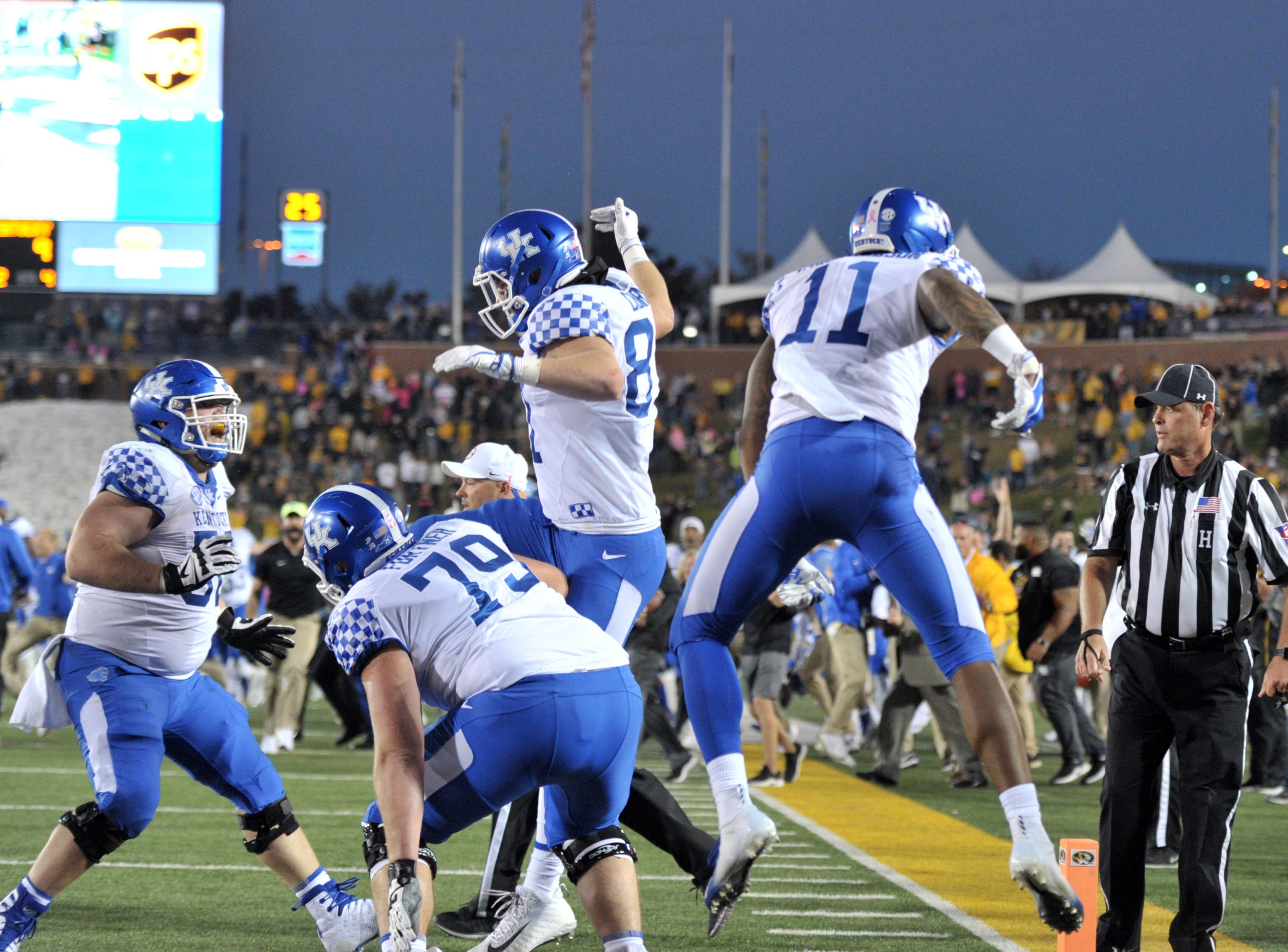 Kentucky Wildcats players celebrate after the win over the Missouri Tigers at Memorial Stadium/Faurot Field.