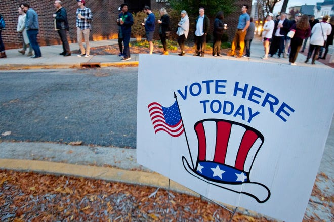 Voters await their turns at the polls on Election Day in Grand Rapids, Mich., on Nov. 8, 2016.