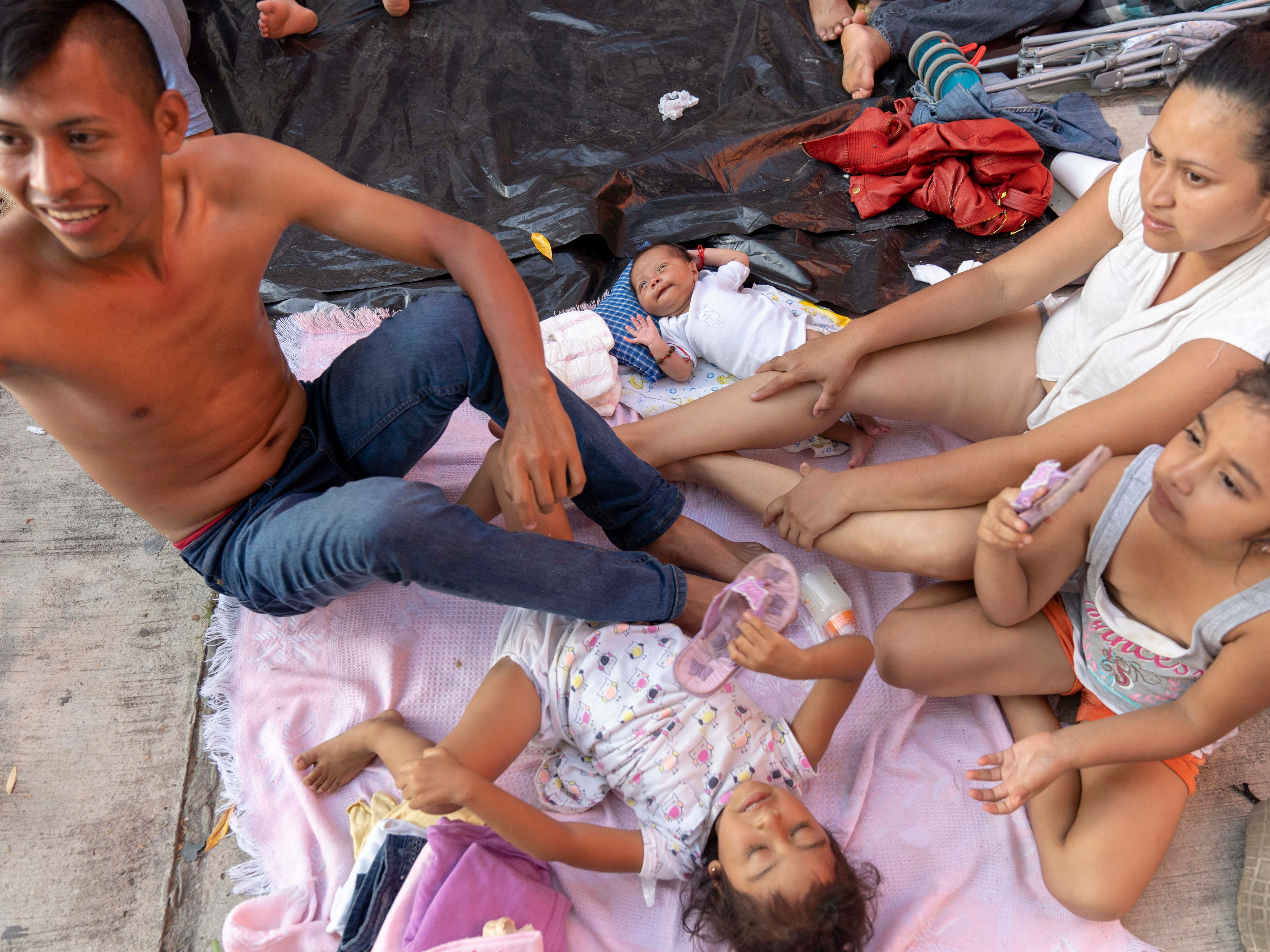 Ernesto Martinez, 27, and his wife Yesenia, 23, are traveling with their three daughters, including a baby who was just 17-days-old when they joined the caravan on Oct. 20. The family is from San Martin, Retalhuleu, Guatemala. They have pushed the baby in a stroller more than 180 miles crossing through the state of Chiapas, before reaching the state of Oaxaca on Oct. 27, 2018.