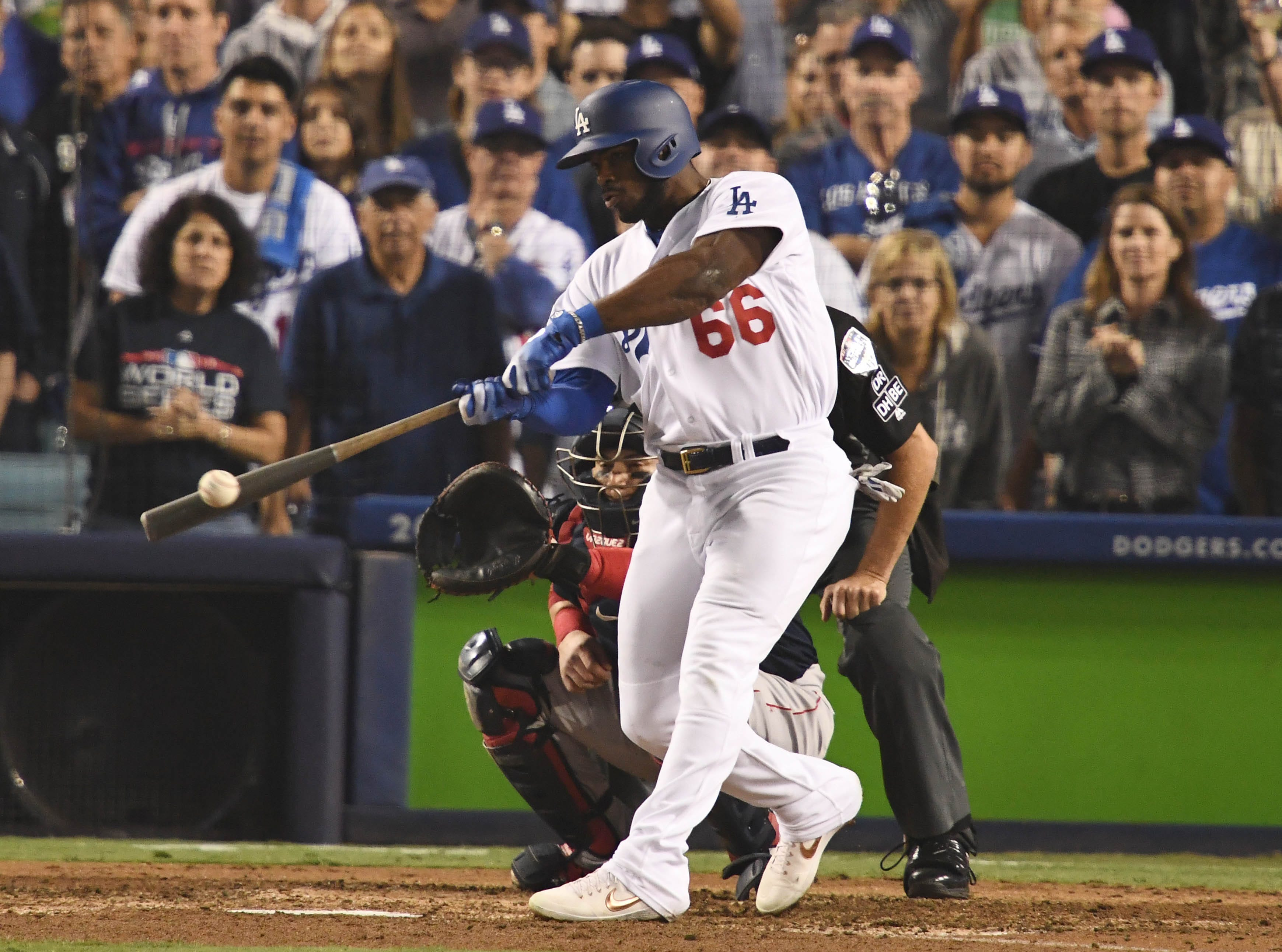 Game 4 at Dodger Stadium: Yasiel Puig hits a three-run homer in the sixth inning.
