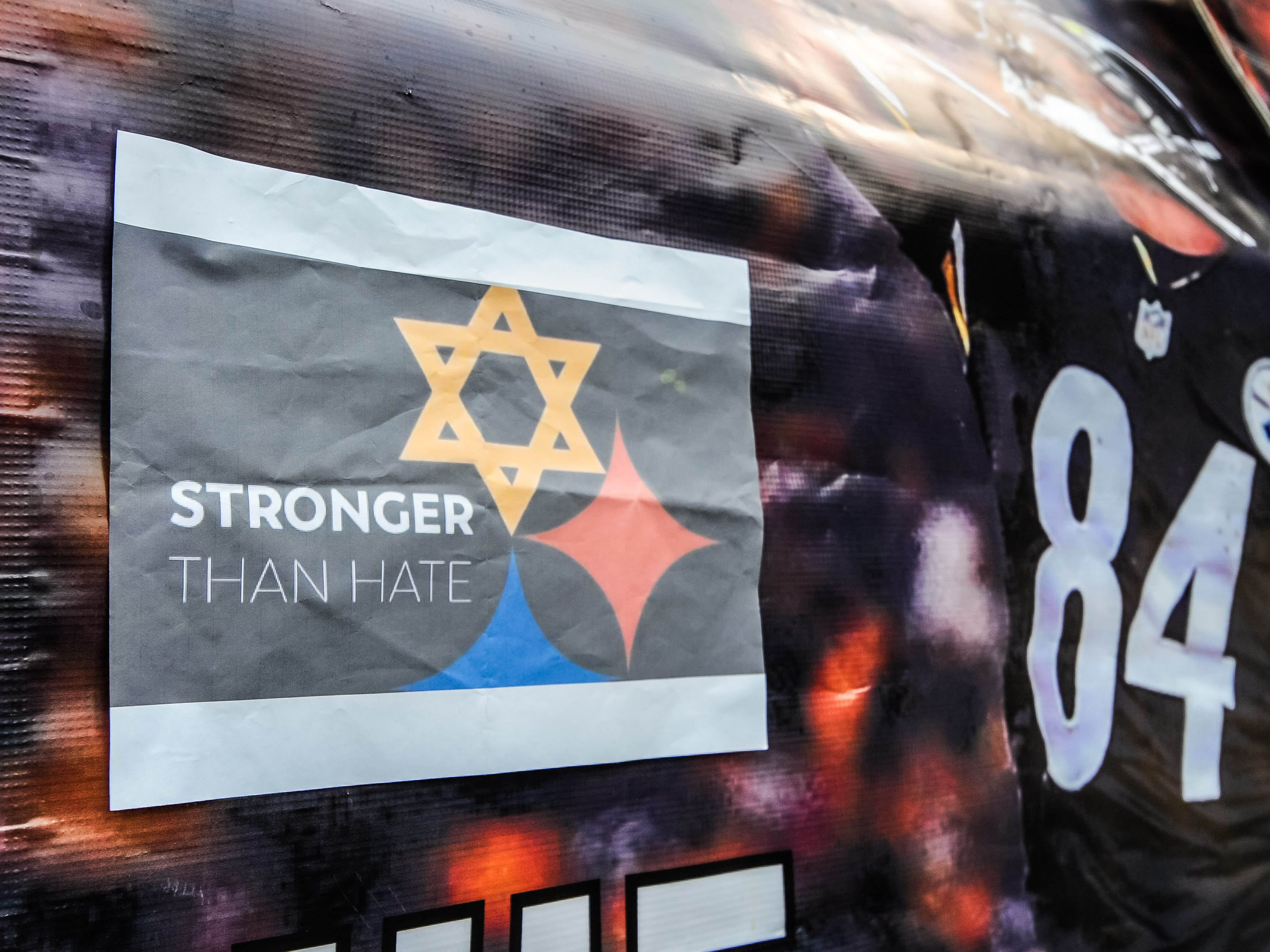 Posters at Heinz Field honor the victims of the shooting at the Tree of Life Synagogue before the game between the Pittsburgh Steelers and the Cleveland Browns, Sunday, Oct. 28, 2018, in Pittsburgh.
