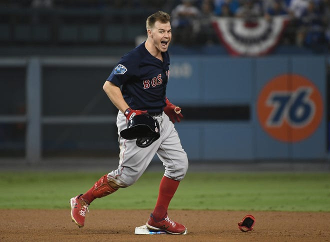 Brock Holt reacts after hitting a double in the ninth inning. He later scored the go-ahead run.