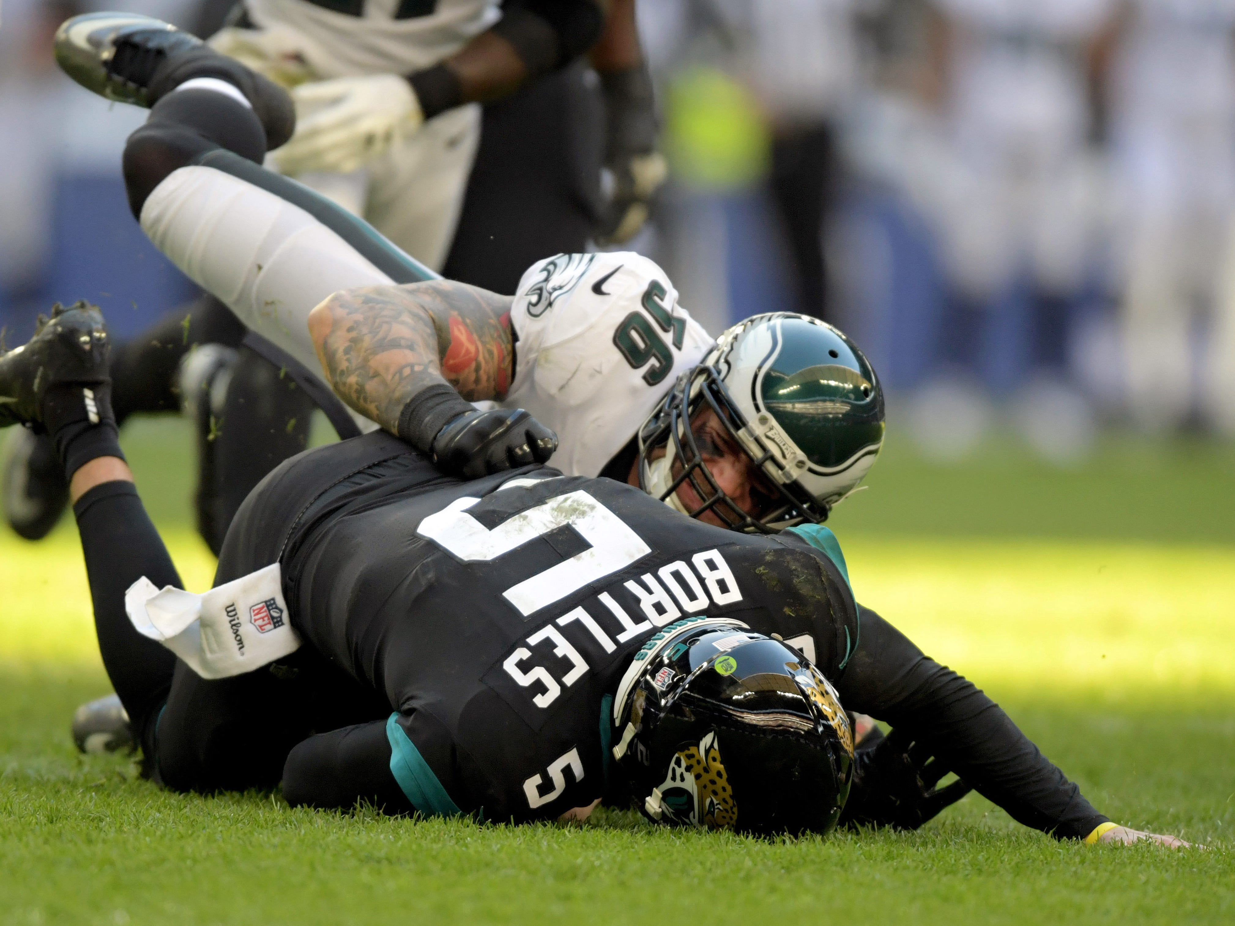 Philadelphia Eagles defensive end Chris Long (56) sakes Jacksonville Jaguars quarterback Blake Bortles (5) in the second quarter at Wembley Stadium.