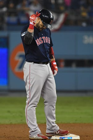 Red Sox first baseman Steve Pearce reacts after hitting a three-run double.