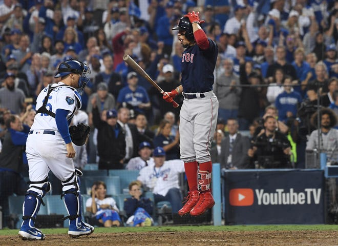 Mookie Betts reacts after striking out in the 15th inning of Game 3.