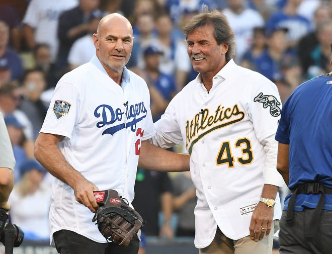 Former Oakland Athletics pitcher Dennis Eckersley and Los Angeles Dodgers outfielder Kirk Gibson take part in the ceremonial pitch.