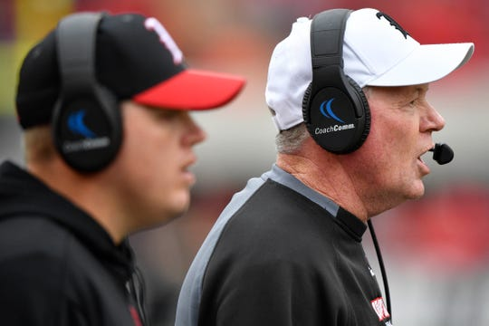 Louisville head coach Bobby Petrino, right, alongside son and quarterbacks coach Nick Petrino, calls out instructions during the Cardinals' loss to Wake Forest.