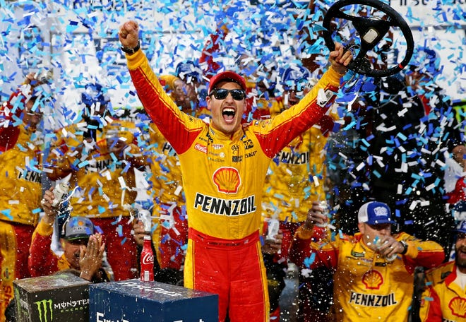 Joey Logano celebrates his second victory of the year.