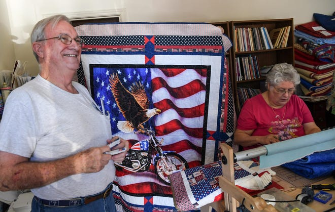 Tommy Forrest, the Anderson County coordinator of Quilts of Valor, works with Anne Medlin, right, of Anderson, to prepare 70 quilts for veterans.