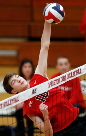 Kimberly's Landon Krause goes for a kill against Appleton East during a match Oct. 23 in Appleton.