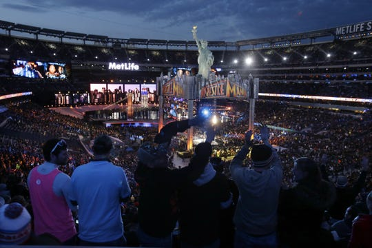 Fans watch the WWE Wrestlemania 29 wrestling event, Sunday, April 7, 2013, in East Rutherford.