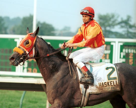 Jose Santos aboard Skip Away after winning the 1996 Haskell Invitational at Monmouth Park.