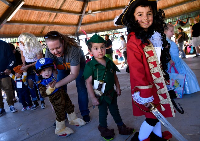 Five-year-old Maddox DeLaGarza (right) shows off his Captain Hook outfit during a costume contest at the Abilene Zoo Saturday. Behind him follows his brother Brennan, 2, as Peter Pan, and their cousin Benjamin Goodwin, also 2, wearing his Paw Patrol costume.