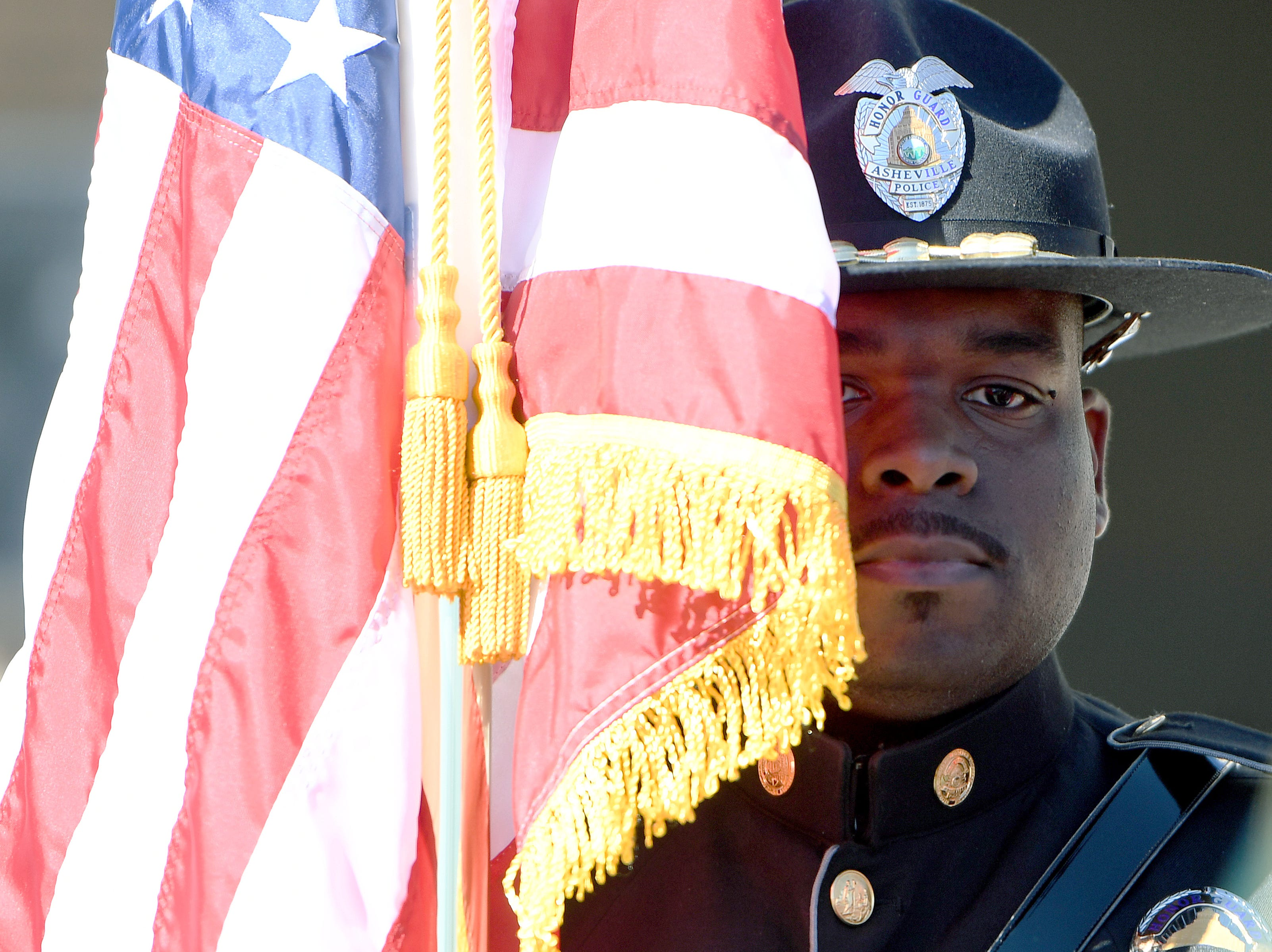 The Asheville Police Department honor guard presents the flag at a ceremony to dedicate a portion of Old Haywood Road to Asheville police officer Robert Bingaman at the Traffic Safety Office on the five-year-anniversary of his death on Oct. 29, 2018.