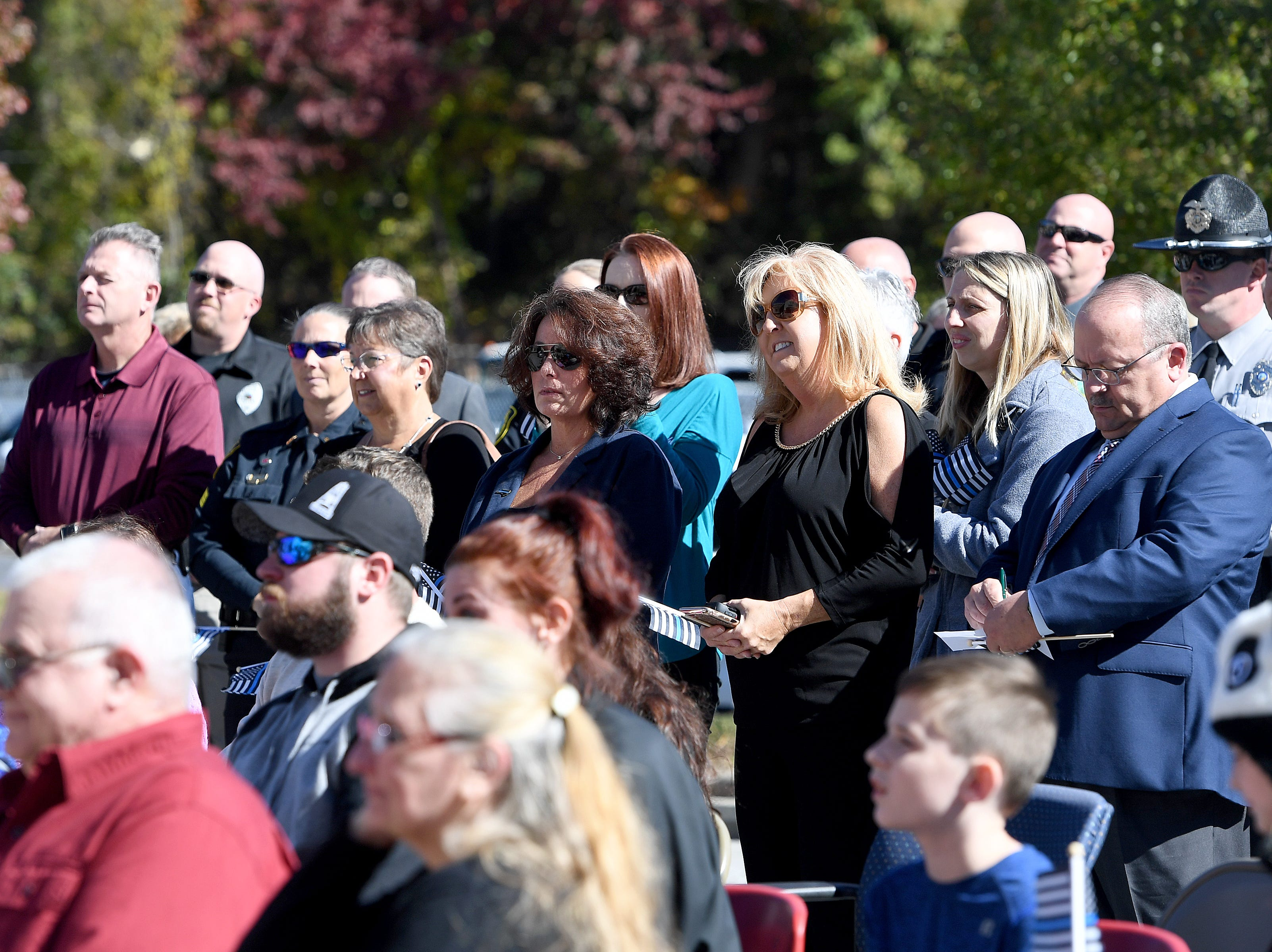 Friends and family attend a ceremony to dedicate a portion of Old Haywood Road to Asheville police officer Robert Bingaman at the Traffic Safety Office on the five-year-anniversary of his death on Oct. 29, 2018.
