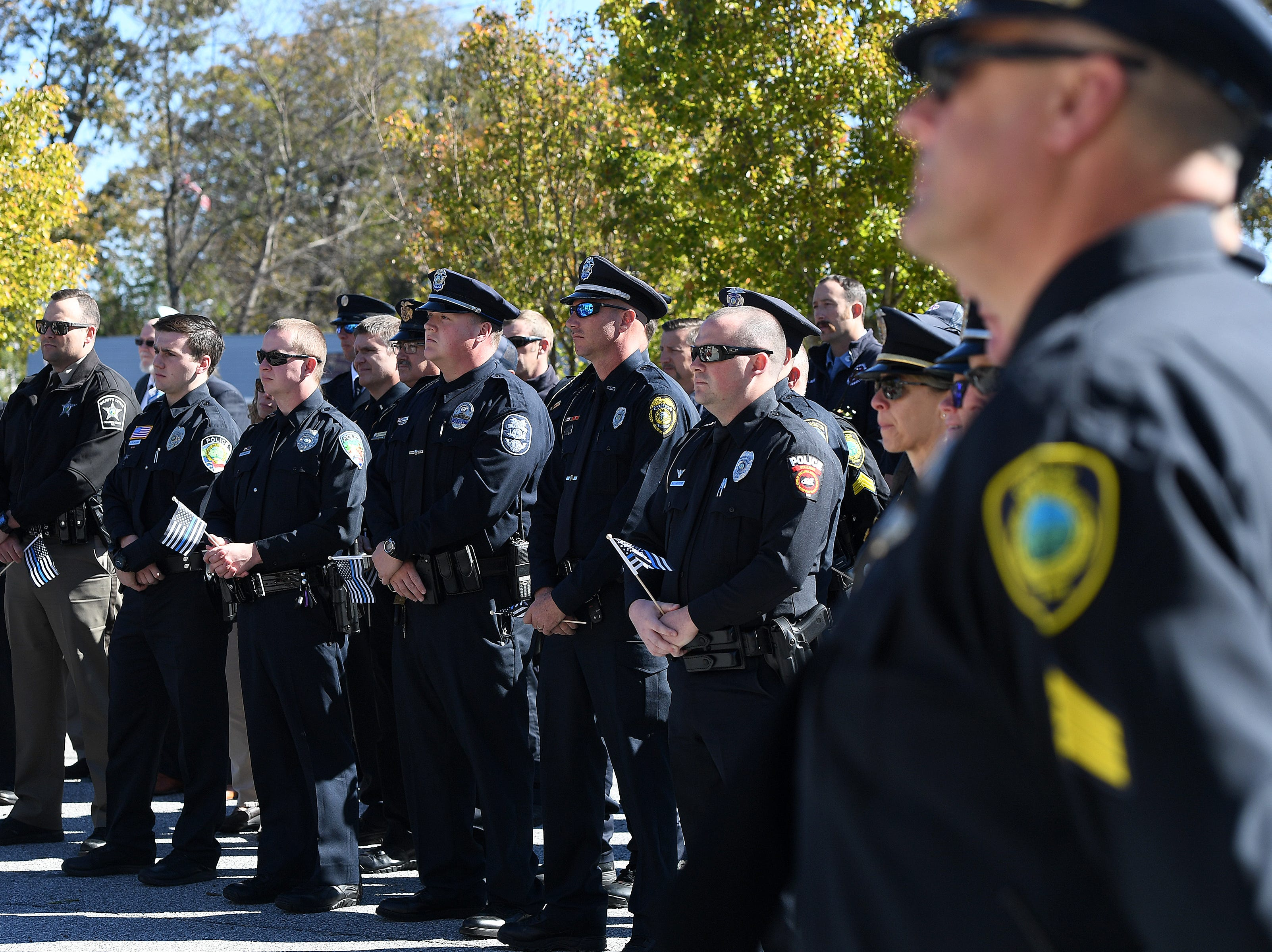 Officers from the Asheville Police Department and other city departments attend a ceremony to dedicate a portion of Old Haywood Road to Asheville police officer Robert Bingaman at the Traffic Safety Office on the five-year-anniversary of his death on Oct. 29, 2018.