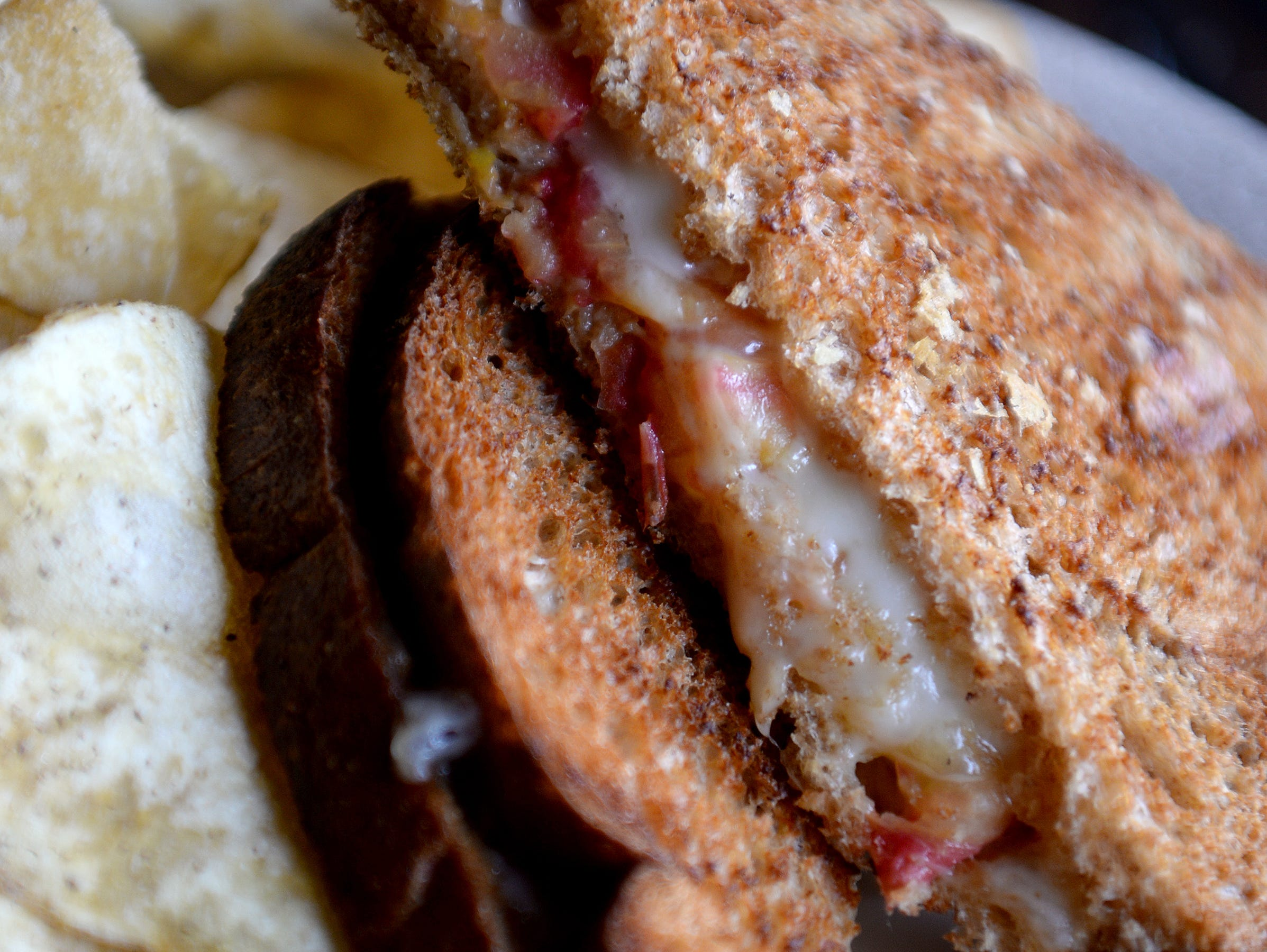 The Culture Club panini at Little Jumbo is Fontina cheese and heirloom tomato on Annie's organic wheat bread. Their sandwiches are accompanied by salt and pepper chips from The Gourmet Chip Co.