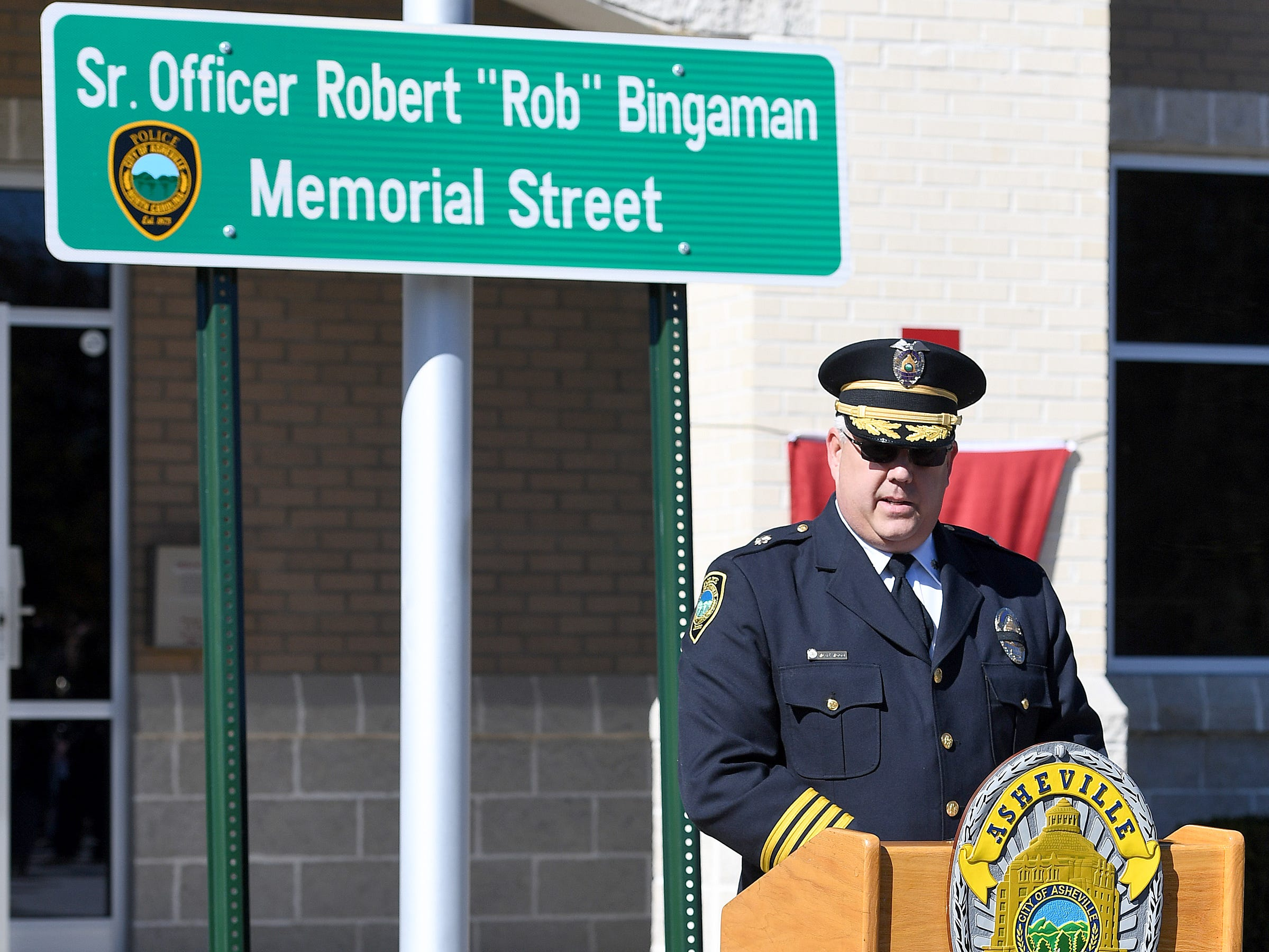 Deputy Chief Wade Wood speaks during a ceremony to dedicate a portion of Old Haywood Road to Asheville police officer Robert Bingaman at the Traffic Safety Office on the five-year-anniversary of his death on Oct. 29, 2018.