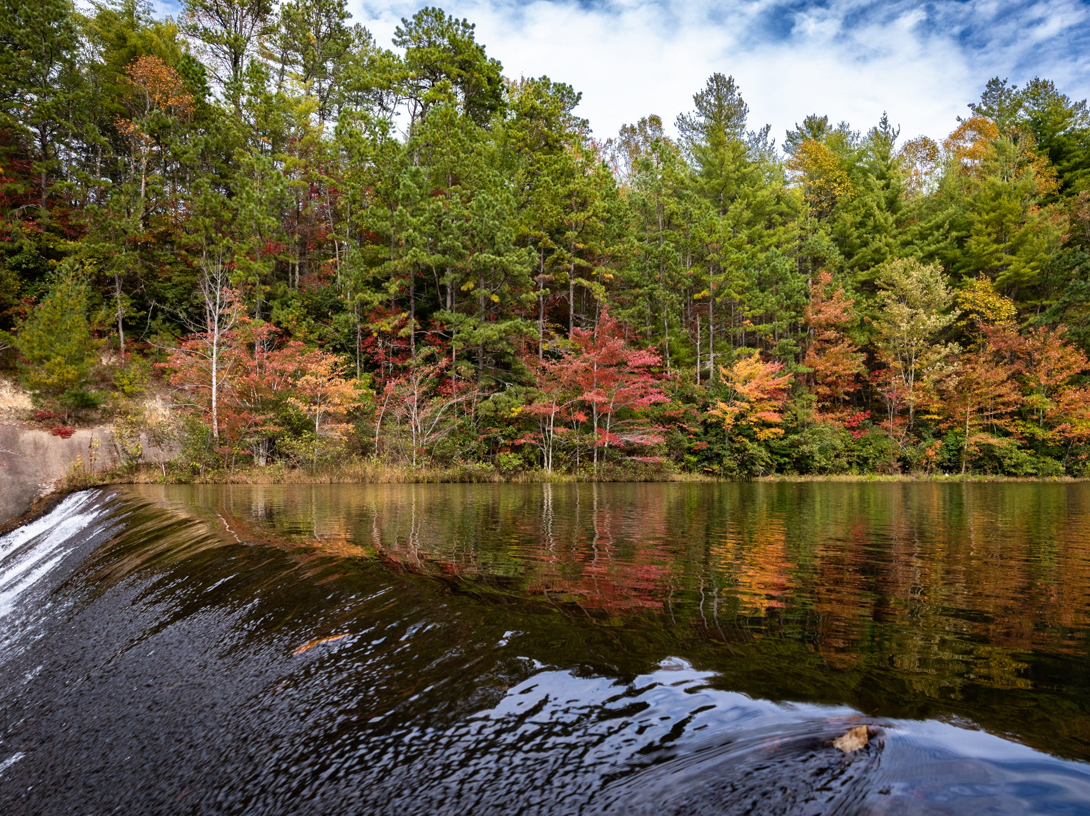 Some light fall color can be seen at the Lake Julia spillway in DuPont State Recreational Forest, Oct. 25, 2018.