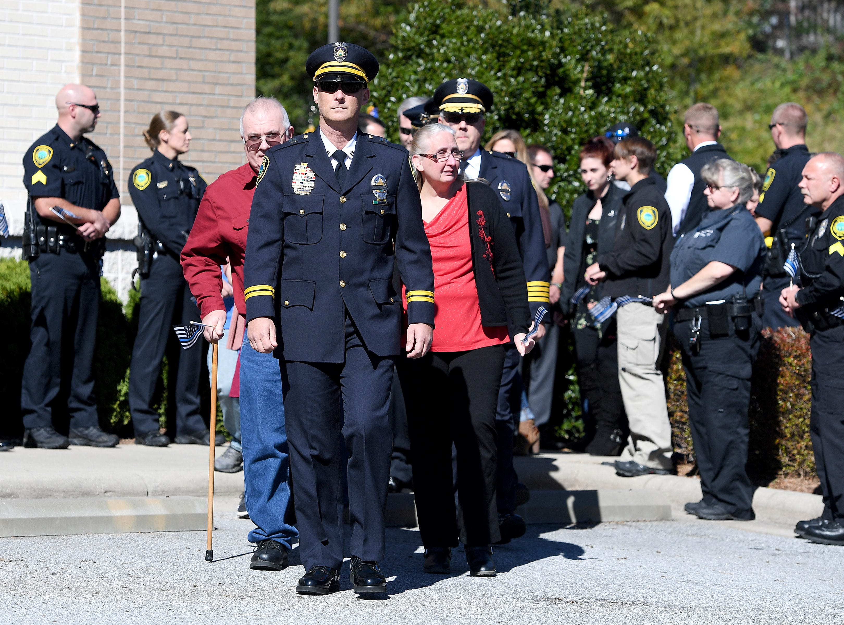 Family of Robert Bingaman are led to their seats for a ceremony to dedicate a portion of Old Haywood Road to the Asheville police officer at the Traffic Safety Office on the five-year-anniversary of his death on Oct. 29, 2018.