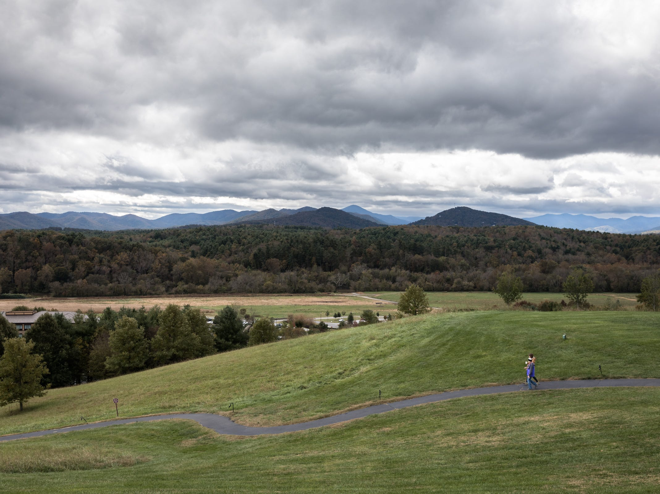 Mountains rise on the horizon as seen from the Biltmore estate Oct. 27, 2018.