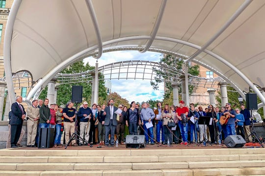 Cross-denominational clergy members stand in support of the Jewish community during a vigil for the victims of the Pittsburgh synagogue shooting.