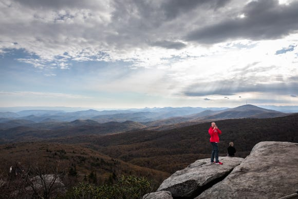 Visitors to Rough Ridge on the Blue Ridge Parkway enjoy the panoramic views from a rocky overhang Oct. 28, 2018.