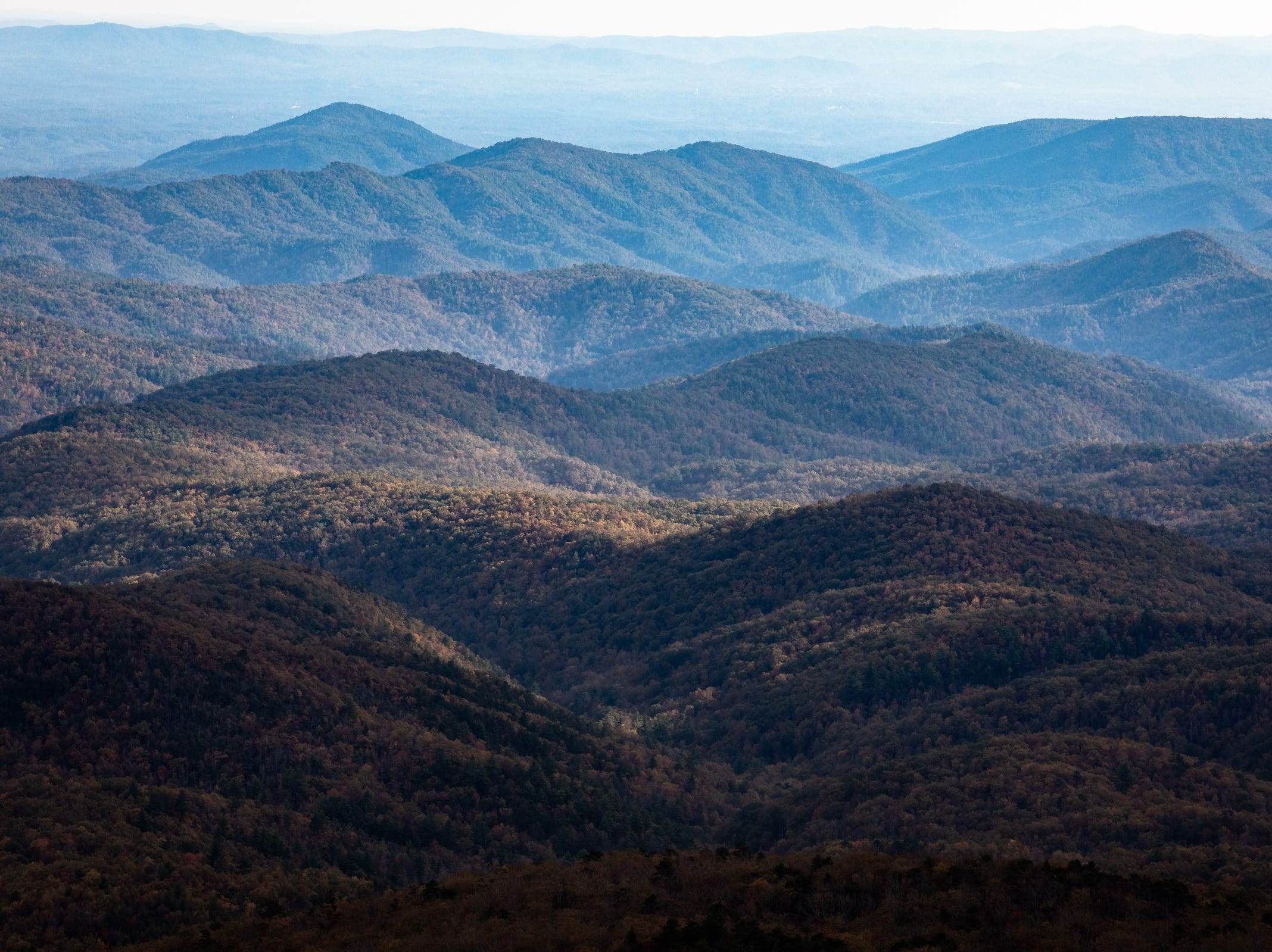 Sun sweeps across the mountains as seen from Rough Ridge on the Blue Ridge Parkway Oct. 28, 2018.