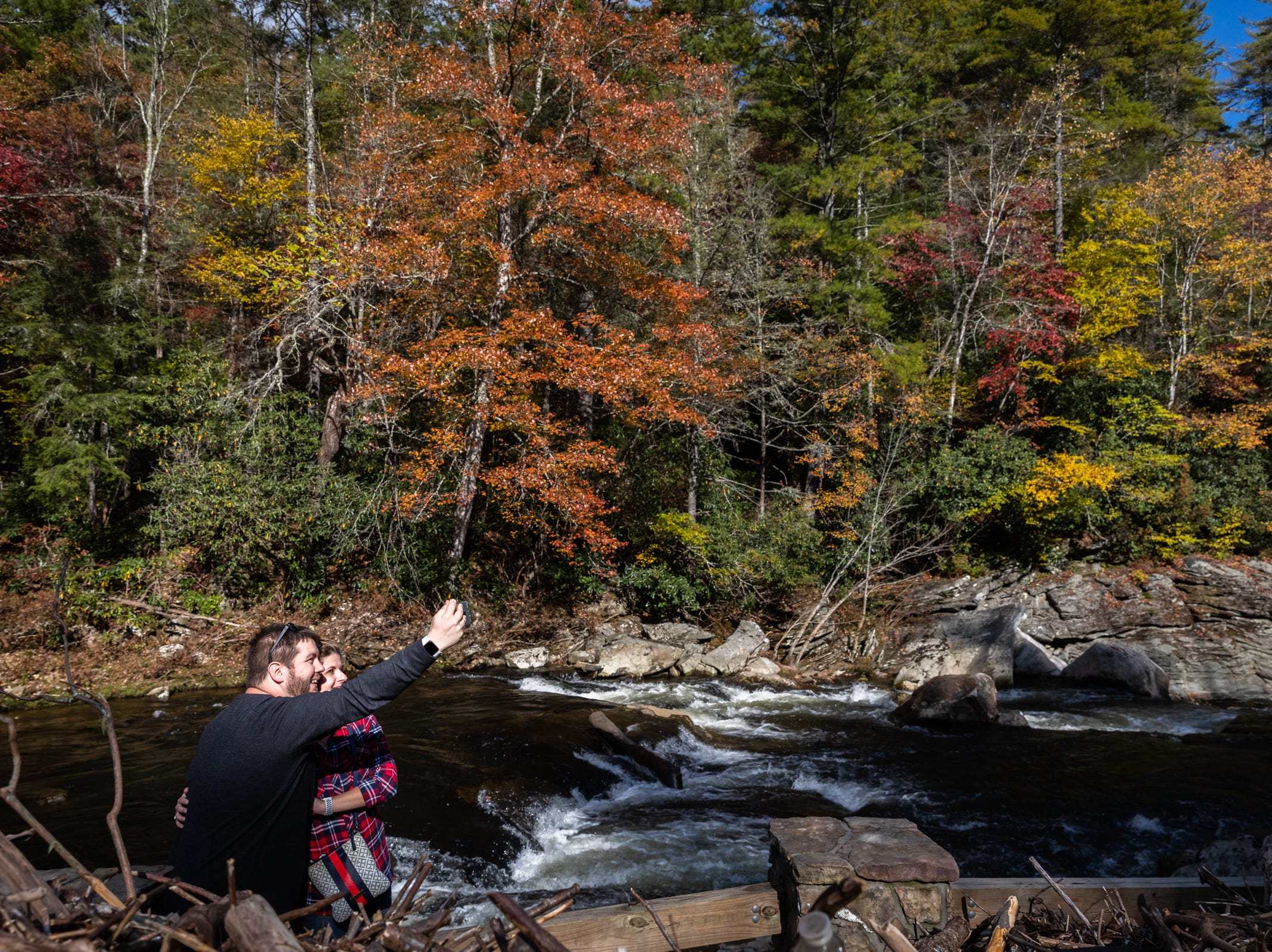 A couple takes a cell phone photograph together at Linville Falls on the Blue Ridge Parkway, Oct. 28, 2018.