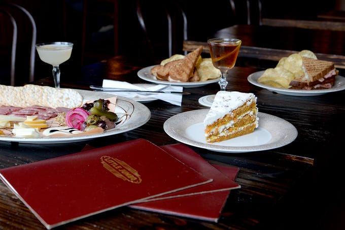 An assortment of food available at Little Jumbo includes cheese and charcuterie plates, sandwiches and desserts.