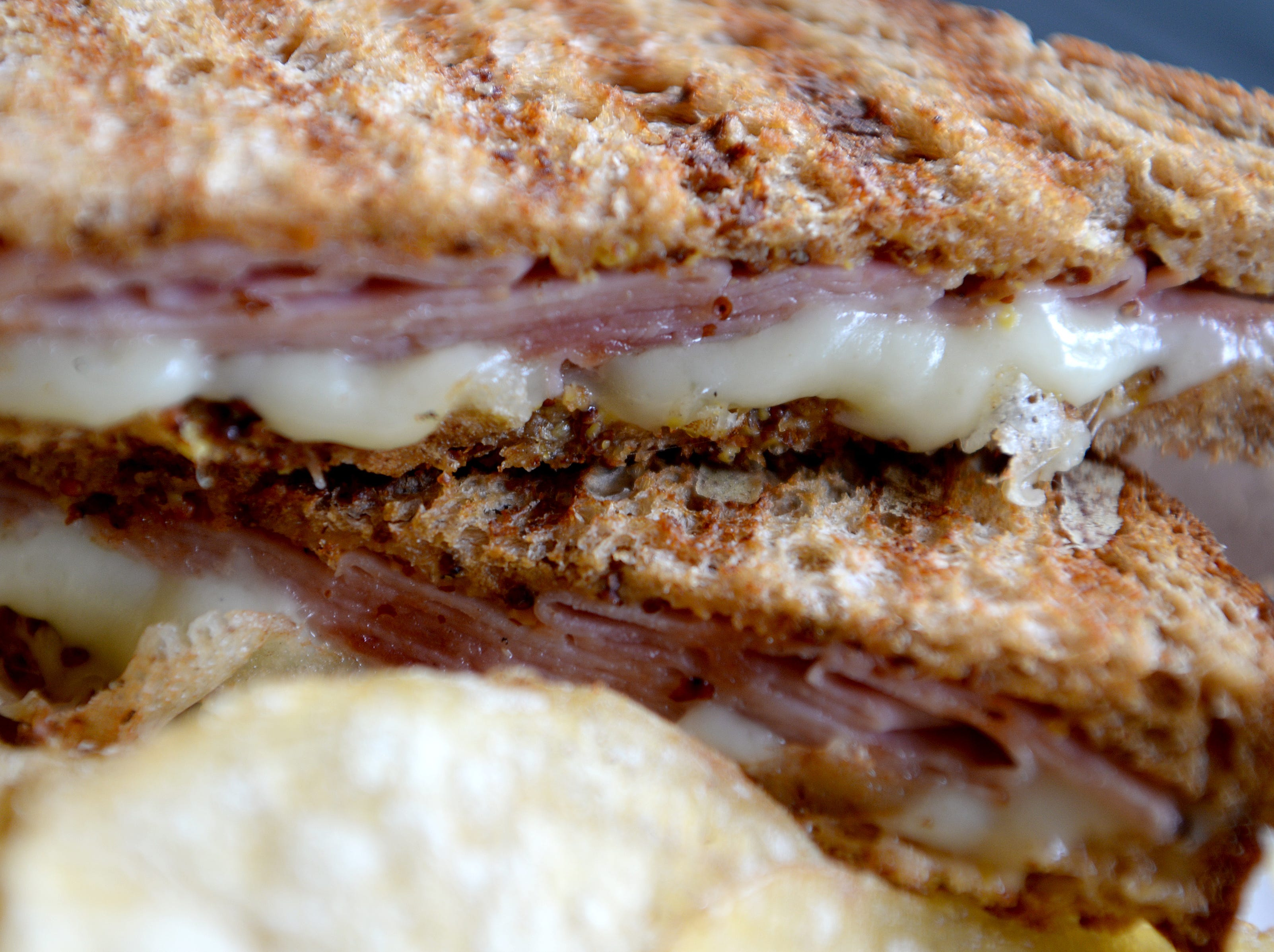 The Huey Lewis Panini at Little Jumbo is ham, gruyere cheese, and whole grain mustard on Annie's organic wheat bread. Their sandwiches are accompanied by salt and pepper chips from The Gourmet Chip Co.