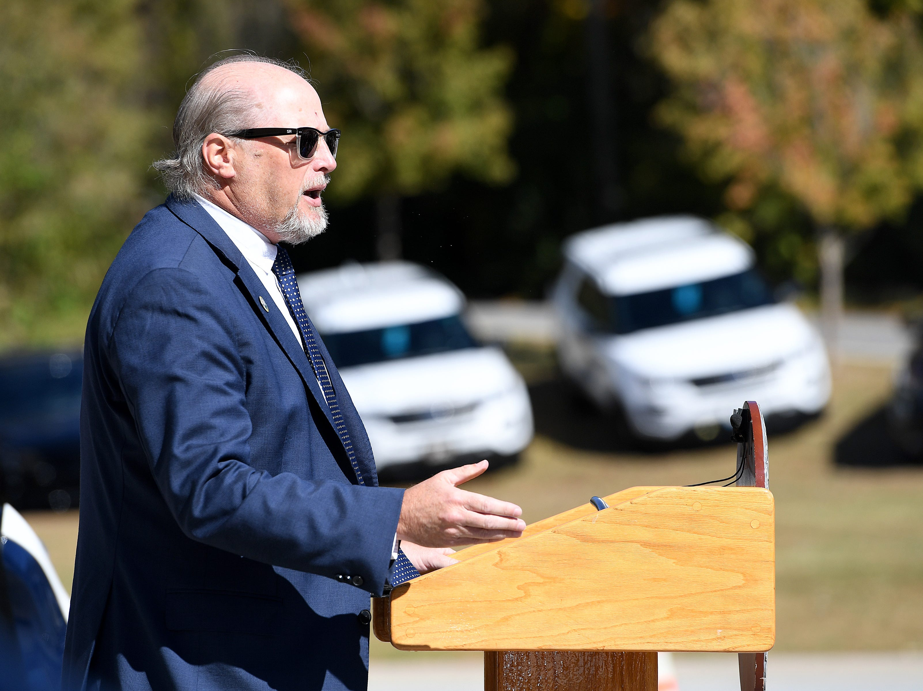 Sgt. retired Rondell Lance, president of the Asheville Fraternal Order of Police, speaks about Robert Bingaman during a ceremony to dedicate a portion of Old Haywood Road to the Asheville police officer at the Traffic Safety Office on the five-year-anniversary of his death on Oct. 29, 2018.